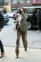 Dakota Johnson Wears a Plaid Blazer and Striped Pants - New York 09/30/2021
