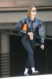 Hailey Rhode Bieber in Black Leather Bomber Jacket and Skintight Leggings (more photos 10/05/2021)
