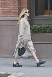 Jennifer Lawrence in a Grey Sweater, Matching Skirt and Christian Dior Handbag - New York 10/06/2021