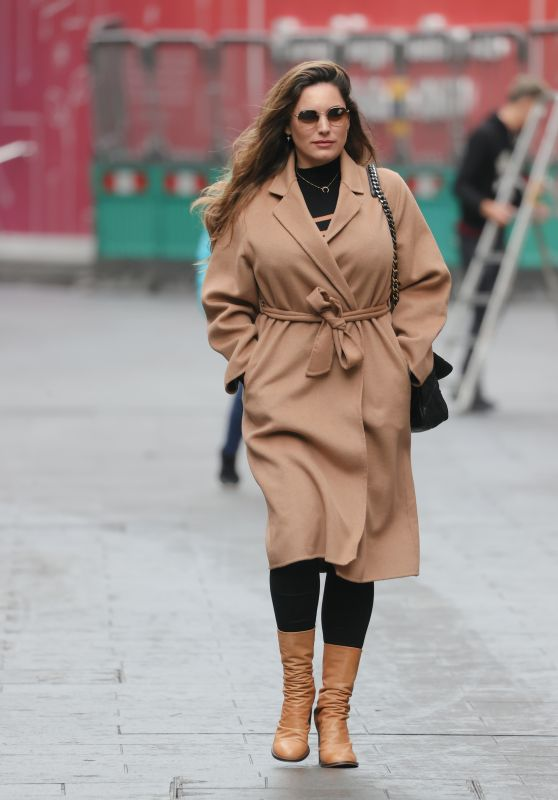 Kelly Brook in Beige Coat and Boots and Black Leggings - London 10/18/2021